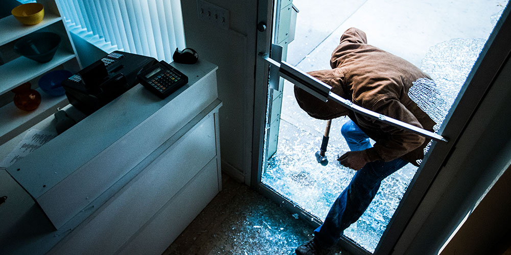 burglar-entering-busines photo_Eyetech Security Systems